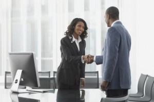 African business people shaking hands